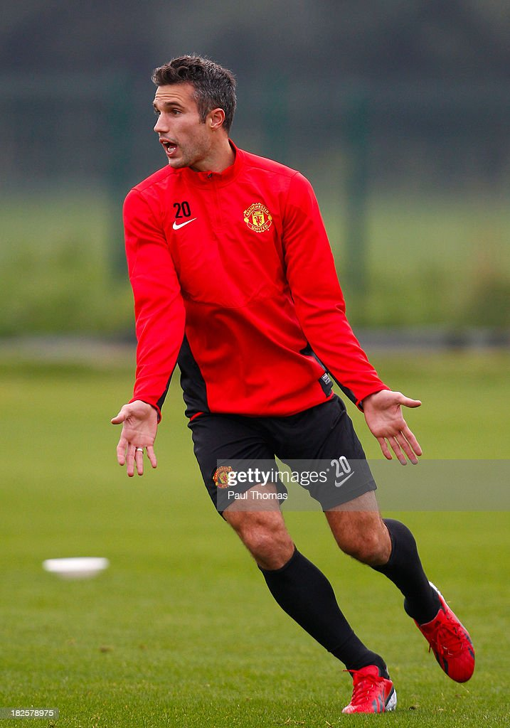 Robin van Persie of Manchester United in action during a training session ahead of their Champions League Group A match against Shakhtar Donetsk at their Carrington Training Complex on October 01, 2013 in Manchester, England