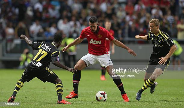 Robin van Persie of Manchester United in action with Ebenezer Ofori of AIK Fotboll during the preseason friendly match between AIK Fotboll and...