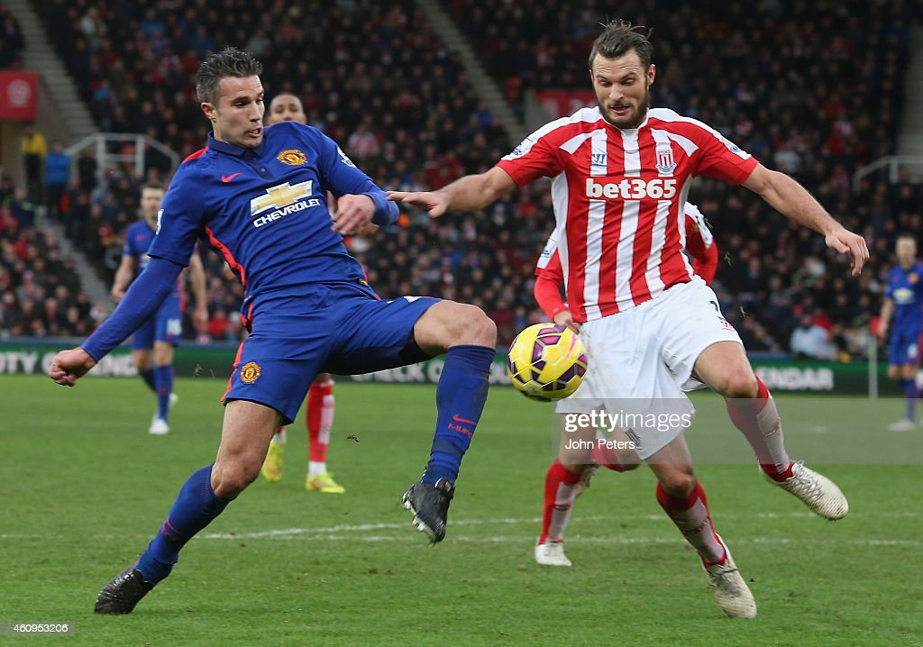 Robin van Persie of Manchester United in action with Erik Pieters of Stoke City during the Barclays Premier League match between Stoke City and Manchester United at Britannia Stadium on January 1, 2015 in Stoke on Trent, England.