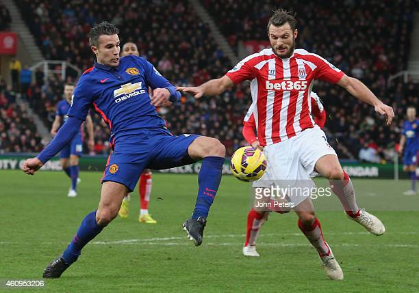 Robin van Persie of Manchester United in action with Erik Pieters of Stoke City during the Barclays Premier League match between Stoke City and...