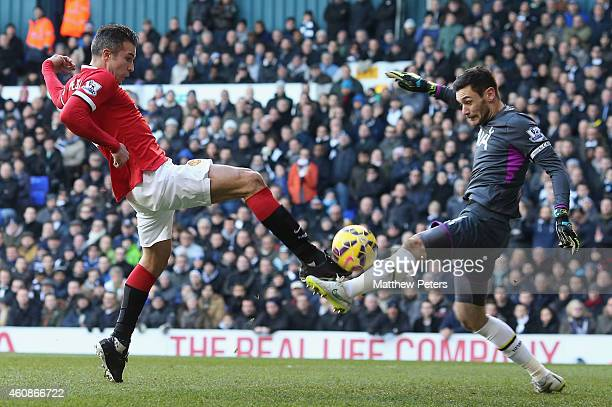 Robin van Persie of Manchester United in action with Hugo Lloris of Tottenham Hotspur during the Barclays Premier League match between Tottenham...