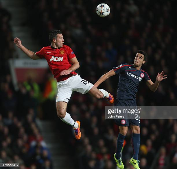 Robin van Persie of Manchester United in action with Ivan Marcano of Olympiacos FC during the UEFA Champions League Round of 16 second leg match...