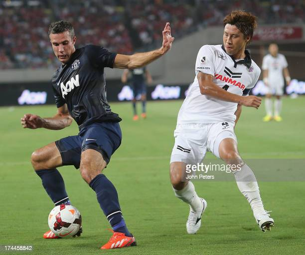 Robin van Persie of Manchester United in action with Kota Fujimoto of Cerezo Osaka during the preseason friendly match between Cerezo Osaka and...