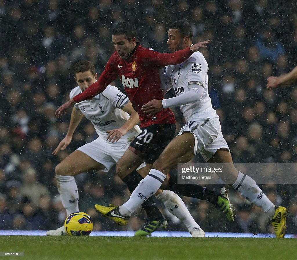 Robin van Persie of Manchester United in action with Michael Dawson (L) and Mousa Dembele of Tottenham Hotspur during the Barclays Premier League match between Tottenham Hotspur and Manchester United at White Hart Lane on January 20, 2013 in London, England.