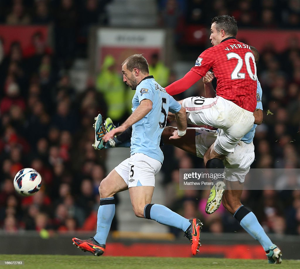 Robin van Persie of Manchester United in action with Pablo Zabaleta of Manchester City during the Barclays Premier League match between Manchester United and Manchester City at Old Trafford on April 8, 2013 in Manchester, England.