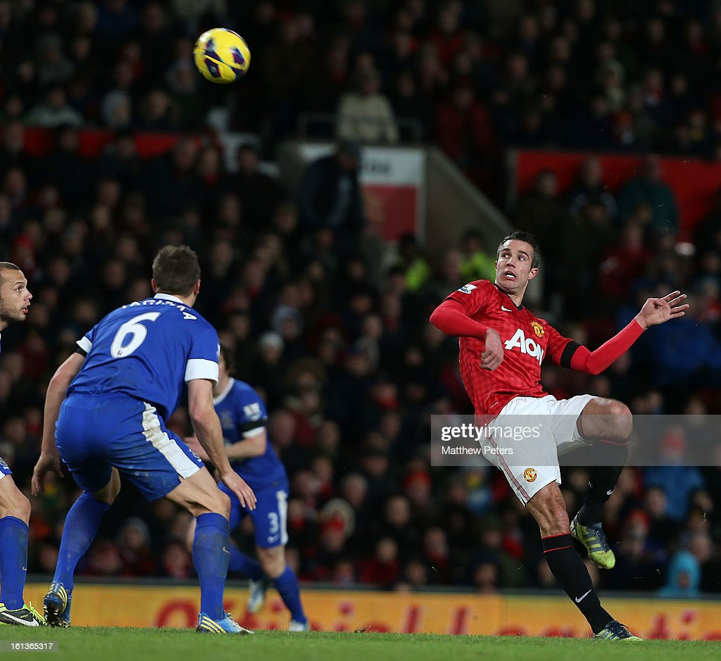 Robin van Persie of Manchester United in action with Phil Jagielka of Everton during the Barclays Premier League match between Manchester United and Everton at Old Trafford on February 10, 2013 in Manchester, England.