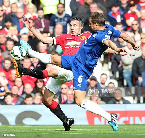 Robin van Persie of Manchester United in action with Phil Jagielka of Everton during the Barclays Premier League match between Manchester United and...