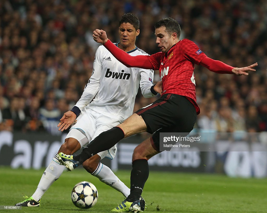 Robin van Persie of Manchester United in action with Raphael Varane of Real Madrid during the UEFA Champions League Round of 16 first leg match between Real Madrid and Manchester United at Estadio Santiago Bernabeu on February 13, 2013 in Madrid, Spain.