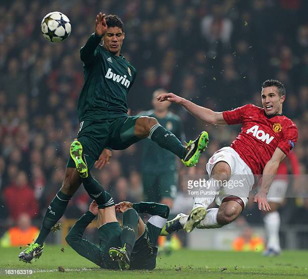 Robin van Persie of Manchester United in action with Raphael Varane of Real Madrid during the UEFA Champions League match between Manchester United...