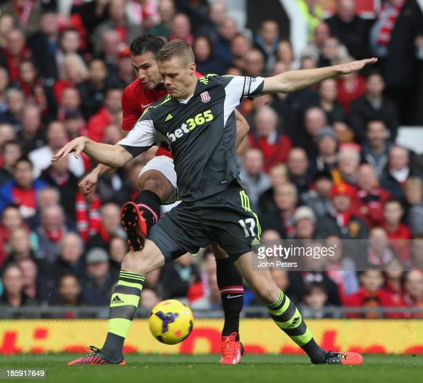 Robin van Persie of Manchester United in action with Ryan Shawcross of Stoke City during the Barclays Premier League match between Manchester United...
