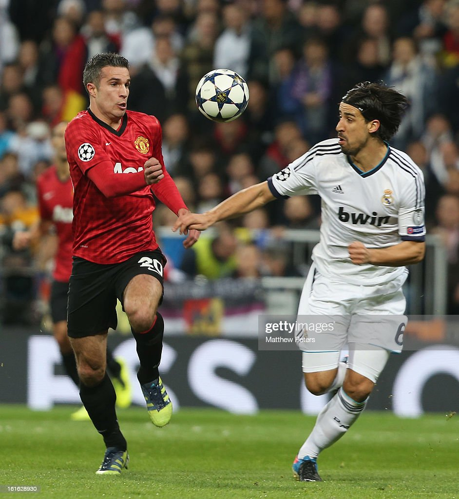 Robin van Persie of Manchester United in action with Sami Khedira of Real Madrid during the UEFA Champions League Round of 16 first leg match between Real Madrid and Manchester United at Estadio Santiago Bernabeu on February 13, 2013 in Madrid, Spain.