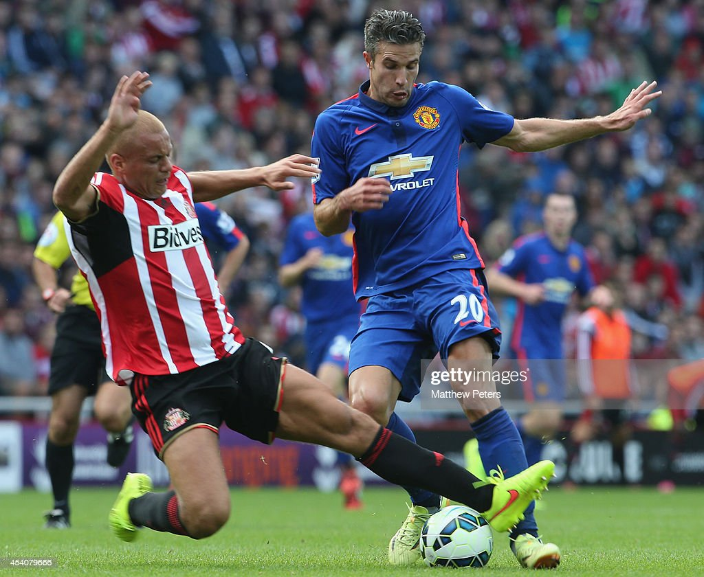 Robin van Persie of Manchester United in action with Wes Brown of Sunderland during the Barclays Premier League match between Sunderland and Manchester United at Stadium of Light on August 24, 2014 in Sunderland, England.