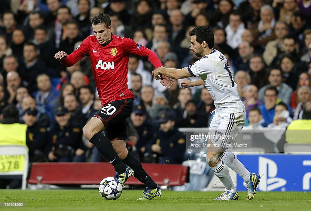 Robin van Persie of Manchester United is challenged by FAlvaro Arbeloa of Real Madrid during the UEFA Champions League Round of 16 first leg match between Real Madrid and Manchester United at Estadio Santiago Bernabeu on February 13, 2013 in Madrid, Spain.