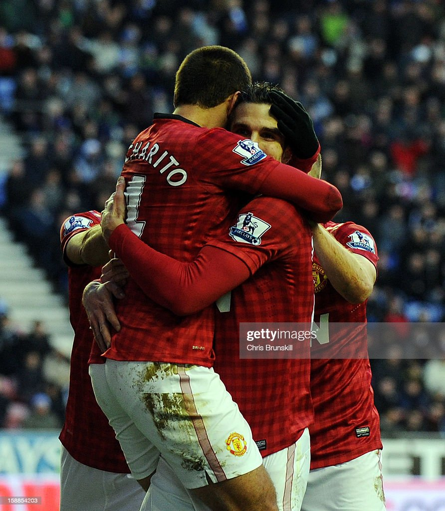 Robin Van Persie of Manchester United is congratulated by team-mate Javier Hernandez after scoring his side's second goal during the Barclays Premier League match between Wigan Athletic and Manchester United at DW Stadium on January 1, 2013 in Wigan, England.