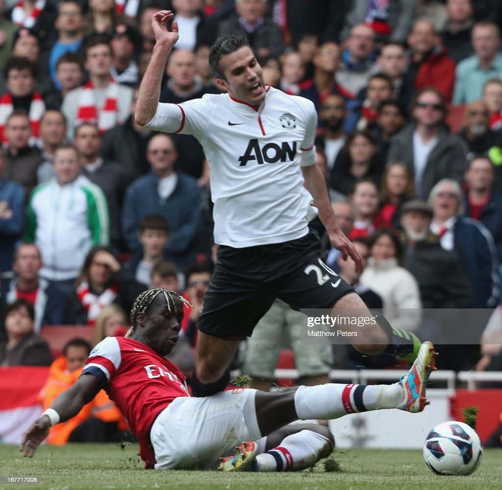 Robin van Persie of Manchester United is fouled by <a gi-track='captionPersonalityLinkClicked' href=/galleries/search?phrase=Bacary+Sagna&family=editorial&specificpeople=745680 ng-click='$event.stopPropagation()'>Bacary Sagna</a> of Arsenal and is awarded a penalty during the Barclays Premier League match between Arsenal and Manchester United at Emirates Stadium on April 28, 2013 in London, England.