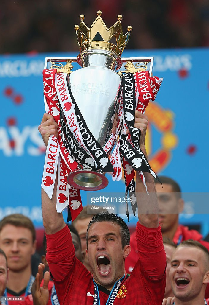 Robin van Persie of Manchester United lifts the Premier League trophy following the Barclays Premier League match between Manchester United and...