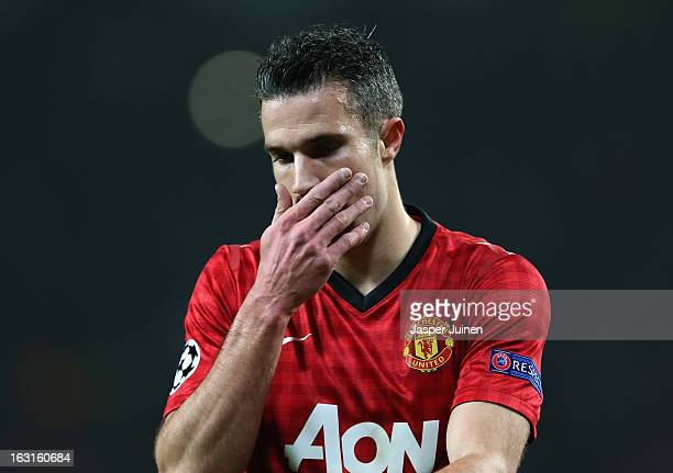 Robin van Persie of Manchester United looks on during the UEFA Champions League Round of 16 Second leg match between Manchester United and Real...