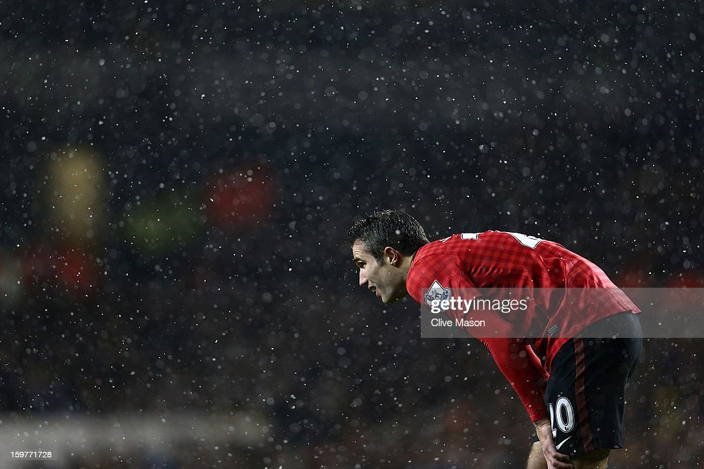 Robin van Persie of Manchester United looks on through the snow during the Barclays Premier League match between Tottenham Hotspur and Manchester United at White Hart Lane on January 20, 2013 in London, England.