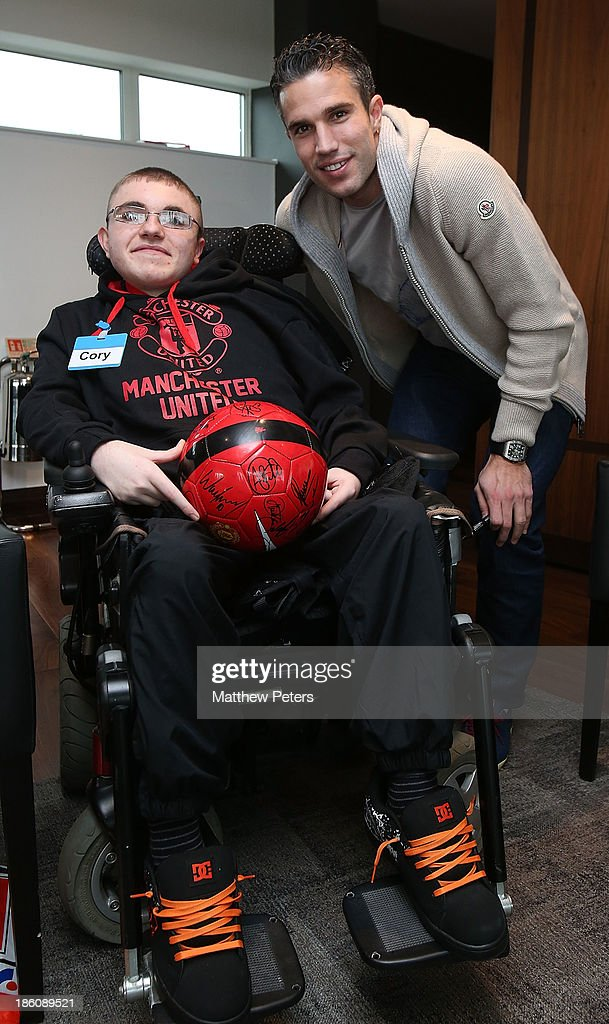 Robin van Persie of Manchester United meets Cory August at a Manchester United Foundation Dream Day, for fans with life-limiting illnesses, at Aon Training Complex on October 28, 2013 in Manchester, England.