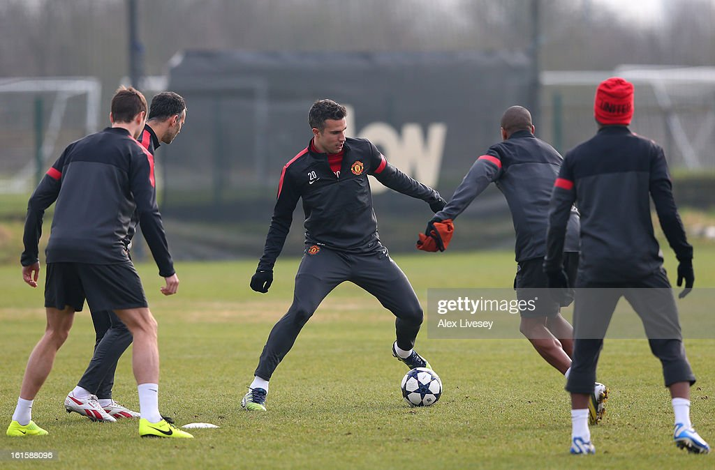 <a gi-track='captionPersonalityLinkClicked' href=/galleries/search?phrase=Robin+Van+Persie&family=editorial&specificpeople=214179 ng-click='$event.stopPropagation()'>Robin Van Persie</a> of Manchester United passes the ball during a training session at the Carrington Training Ground on February 12, 2013 in Manchester, England.