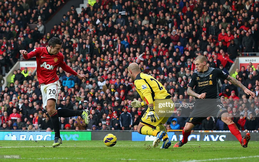 Robin van Persie of Manchester United performs a back-heeled attempt on goal during the Barclays Premier League match between Manchester United and Liverpool at Old Trafford on January 13, 2013 in Manchester, England.