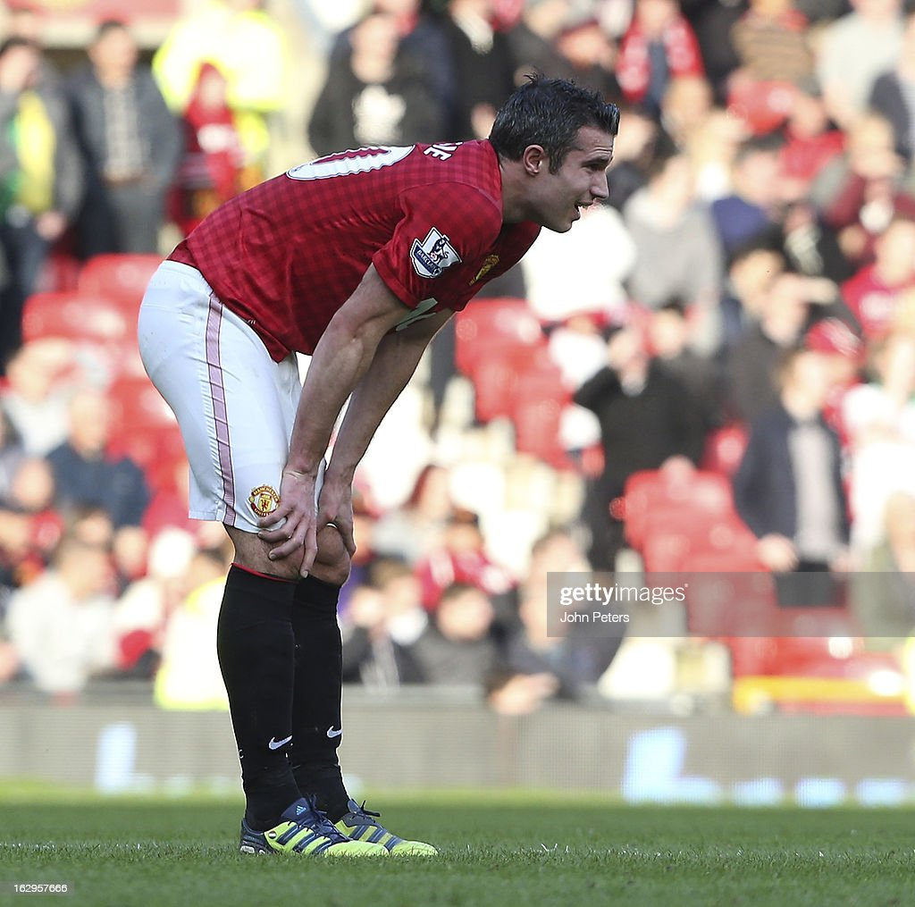 Robin van Persie of Manchester United picks up an injury during the Barclays Premier League match between Manchester United and Norwich City at Old Trafford on March 2, 2013 in Manchester, England.