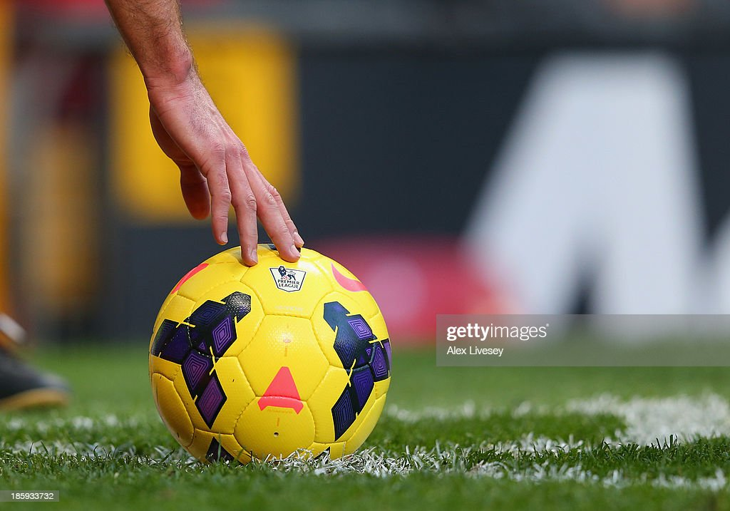 Robin Van Persie of Manchester United places the Highvis Nike Incyte match ball down for a corner kick during the Barclays Premier League match...