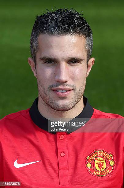 Robin van Persie of Manchester United poses at the annual club photocall at Old Trafford on September 26 2013 in Manchester England