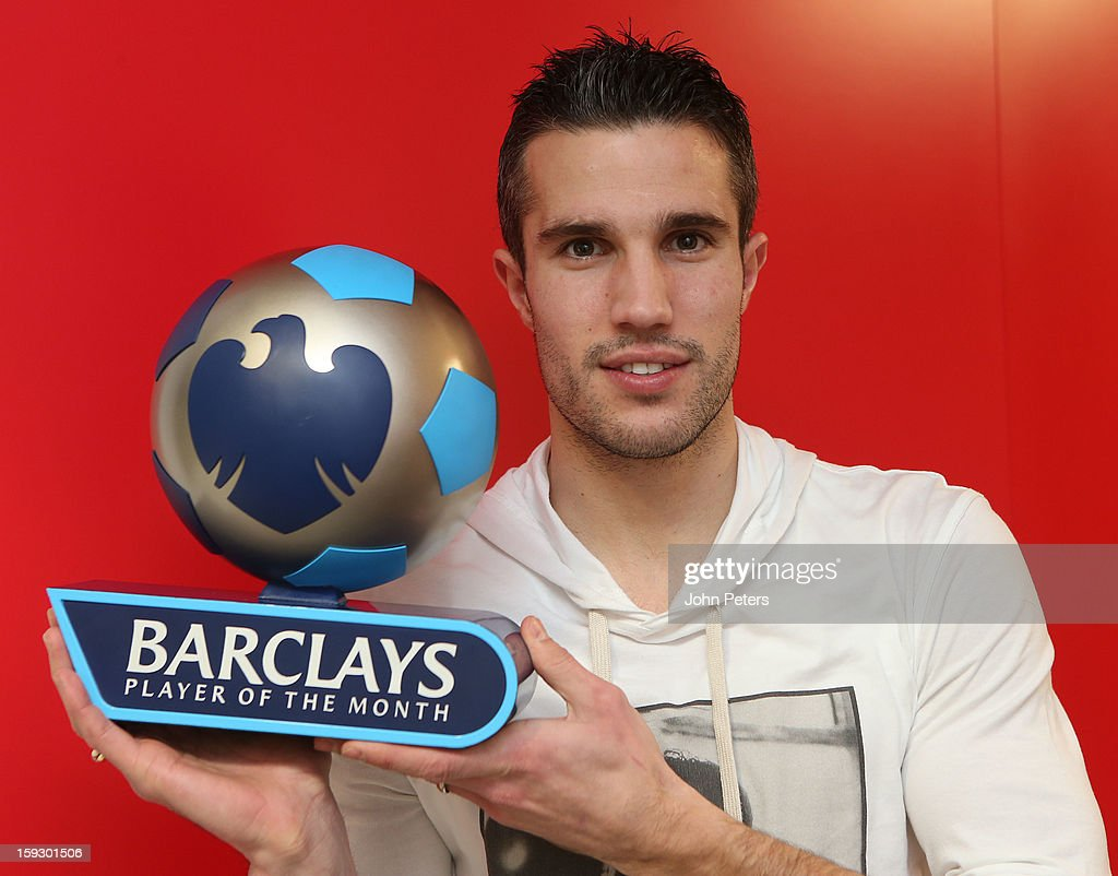 Robin van Persie of Manchester United poses with his Barclays Player of the Month award for December 2012 at Carrington Training Ground on January 11, 2013 in Manchester, England.