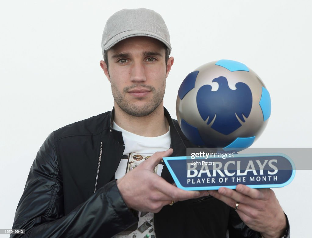 <a gi-track='captionPersonalityLinkClicked' href=/galleries/search?phrase=Robin+van+Persie&family=editorial&specificpeople=214179 ng-click='$event.stopPropagation()'>Robin van Persie</a> of Manchester United poses with the Barclays Player of the Month award for April 2013 at Carrington Training Ground on May 3, 2013 in Manchester, England.