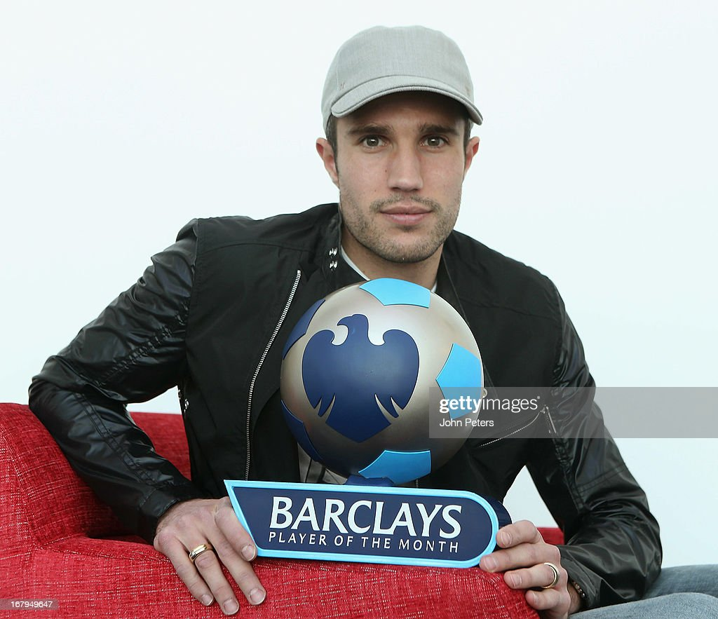 Robin van Persie of Manchester United poses with the Barclays Player of the Month award for April 2013 at Carrington Training Ground on May 3, 2013 in Manchester, England.