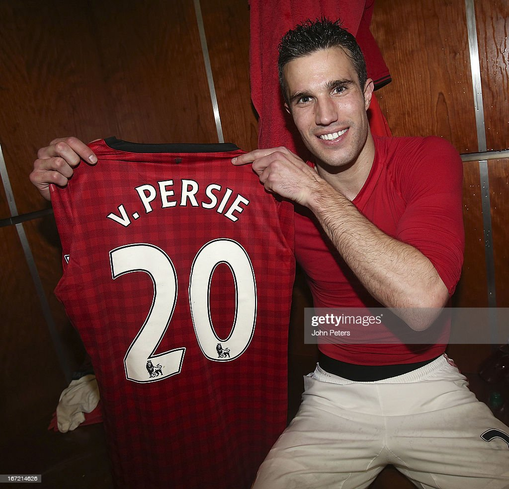 Robin van Persie of Manchester United poses with the number 20 shirt to denote 20 League titles won by Manchester United after the Barclays Premier League match between Manchester United and Aston Villa at Old Trafford on April 22, 2013 in Manchester, England.