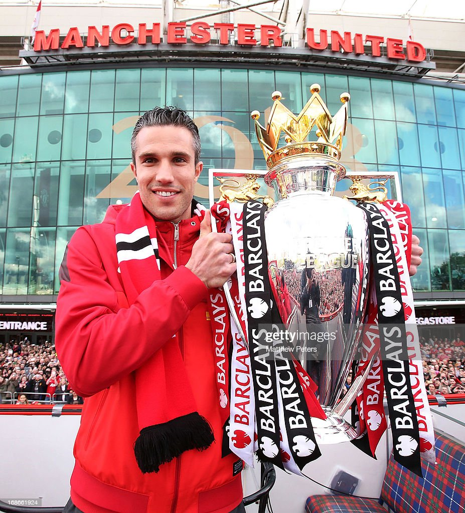 Robin van Persie of Manchester United poses with the Premier League trophy at the start of the Premier League trophy winners parade on May 13, 2013 in Manchester, England.