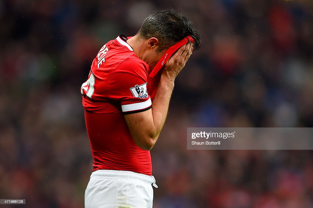 Robin van Persie of Manchester United reacts after missing a penalty during the Barclays Premier League match between Manchester United and West Bromwich Albion at Old Trafford on May 2, 2015 in Manchester, England.