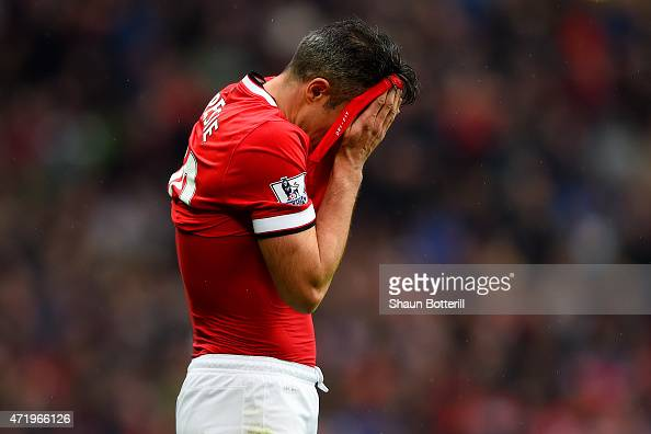 Robin van Persie of Manchester United reacts after missing a penalty during the Barclays Premier League match between Manchester United and West...