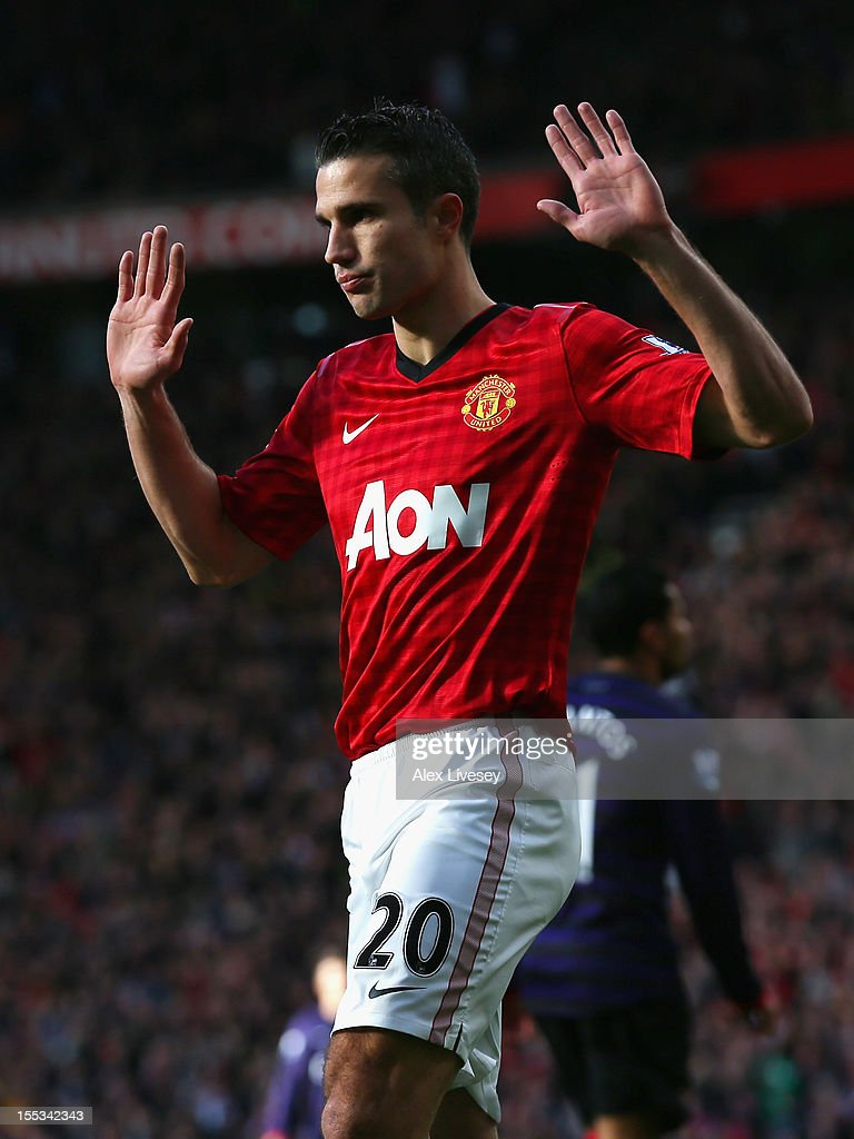 Robin van Persie of Manchester United reacts after scoring the opening goal during the Barclays Premier League match between Manchester United and Arsenal at Old Trafford on November 3, 2012 in Manchester, England.