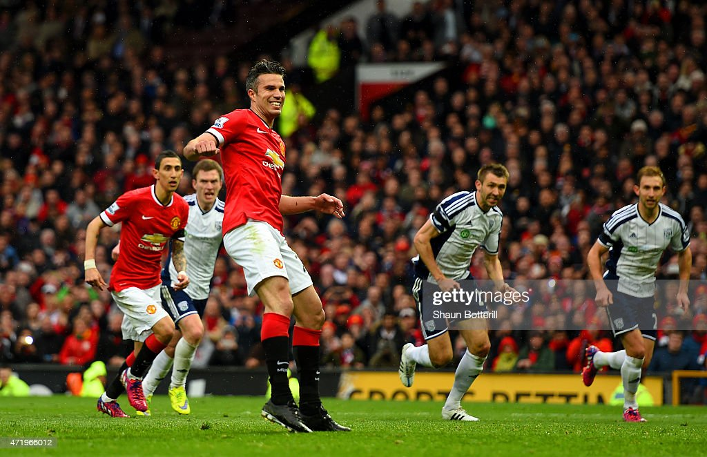 Robin van Persie of Manchester United reacts after taking a penalty which is saved by Boaz Myhill of West Brom during the Barclays Premier League match between Manchester United and West Bromwich Albion at Old Trafford on May 2, 2015 in Manchester, England.