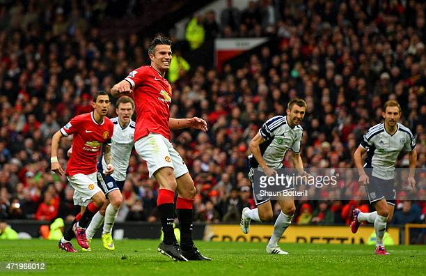 Robin van Persie of Manchester United reacts after taking a penalty which is saved by Boaz Myhill of West Brom during the Barclays Premier League...