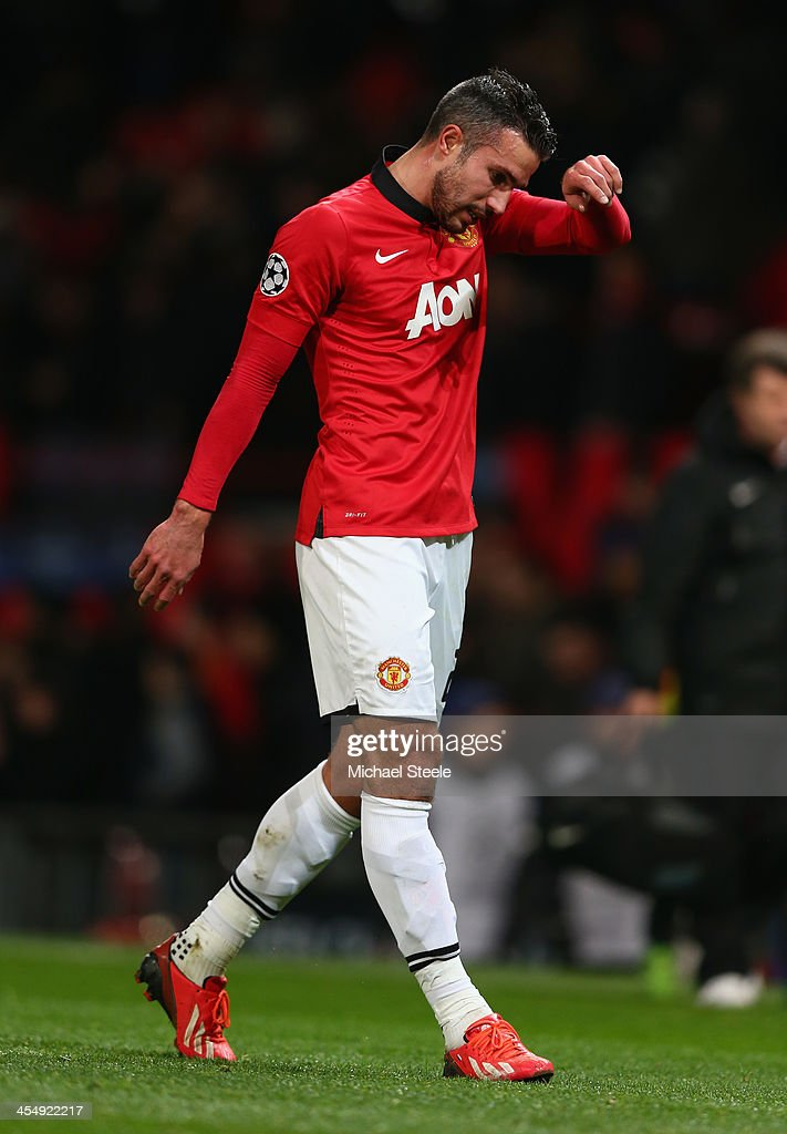 Robin van Persie of Manchester United reacts during the UEFA Champions League Group A match between Manchester United and Shakhtar Donetsk at Old Trafford on December 10, 2013 in Manchester, England.