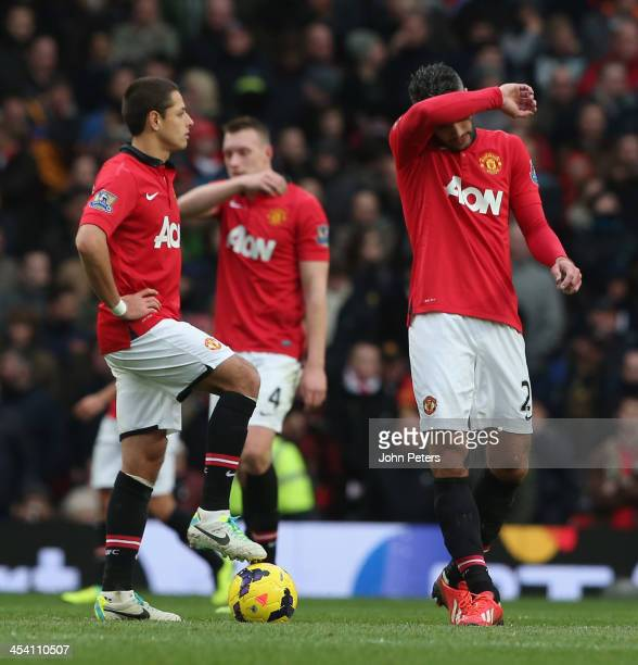Robin van Persie of Manchester United reacts to conceding a goal to Yohan Cabaye of Newcastle United during the Barclays Premier League match between...