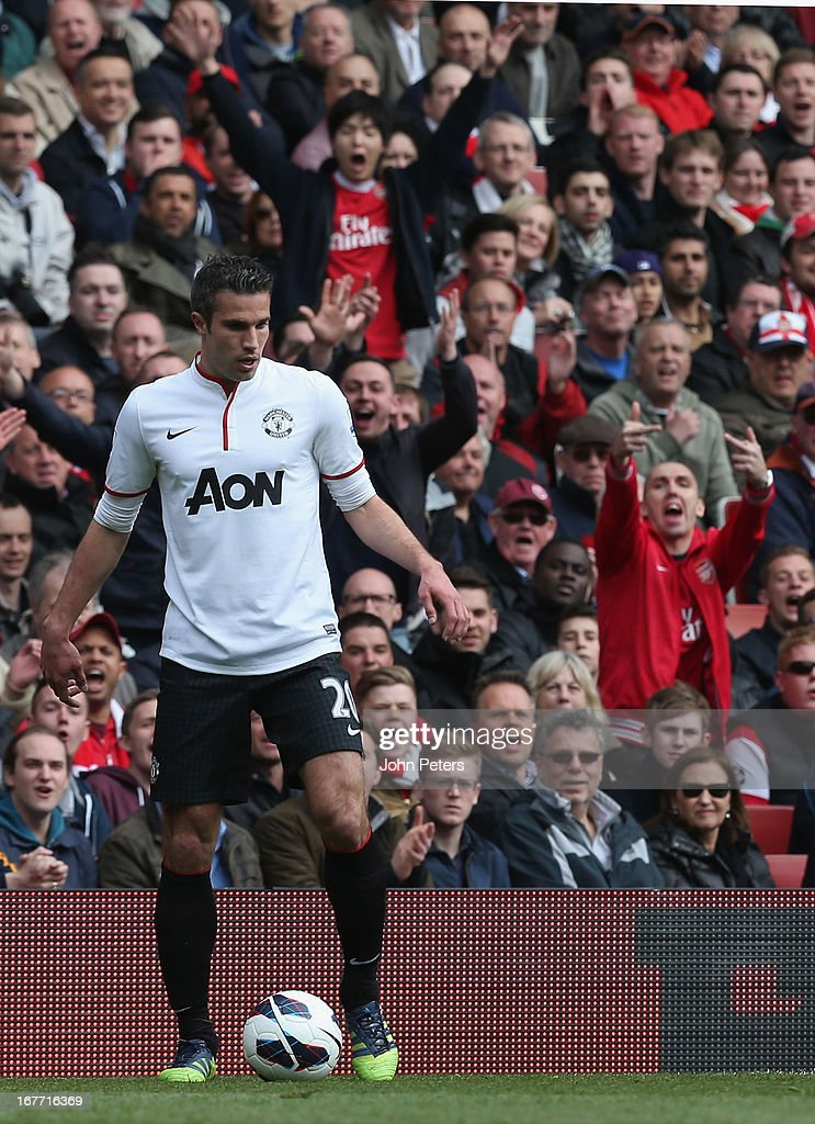 Robin van Persie of Manchester United receives a mixed reception on his return to Arsenal during the Barclays Premier League match between Arsenal and Manchester United at Emirates Stadium on April 28, 2013 in London, England.