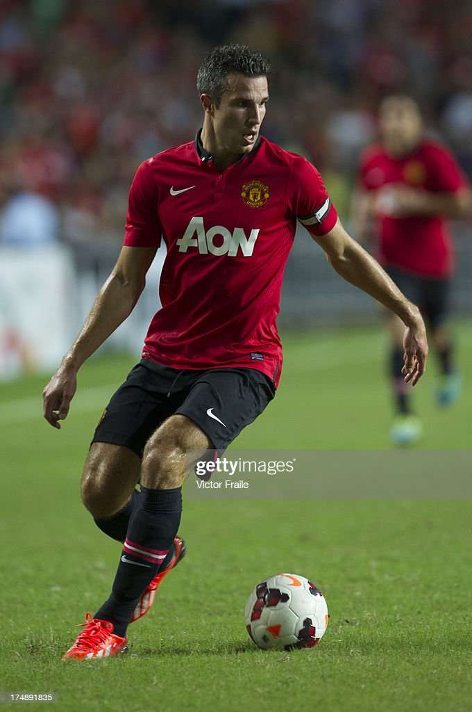 Robin Van Persie of Manchester United runs with the ball during the international friendly match between Kitchee FC and Manchester United at Hong Kong Stadium on July 29, 2013 in So Kon Po, Hong Kong.