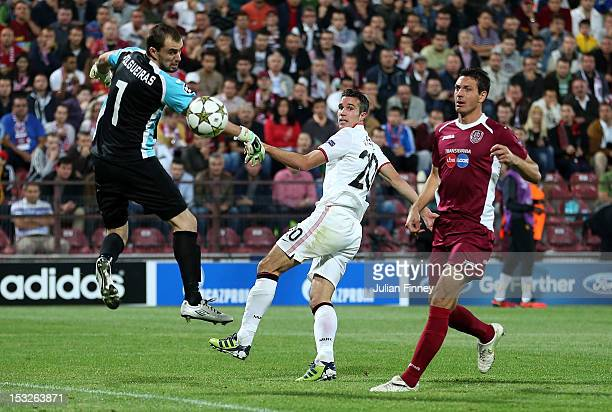 Robin van Persie of Manchester United scores a goal to make it 21 during the UEFA Champions League Group H match between CFR 1907 Cluj and Manchester...