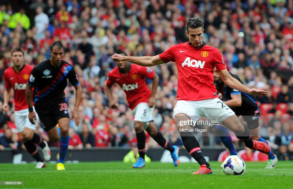 Robin van Persie of Manchester United scores from the penalty spot during the Barclays Premier League match between Manchester United and Crystal Palace at Old Trafford on September 14, 2013 in Manchester, England.