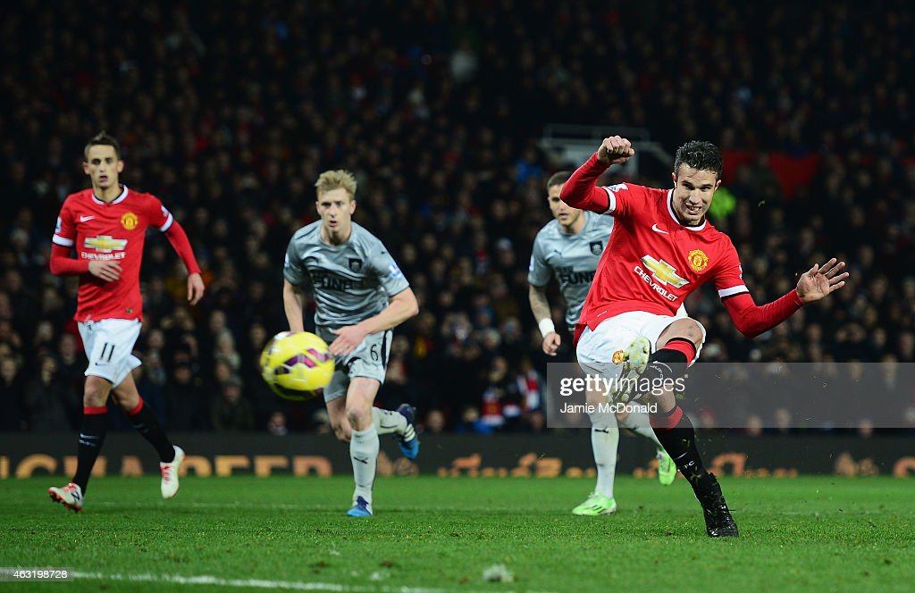 Robin van Persie of Manchester United scores from the penalty spot during the Barclays Premier League match between Manchester United and Burnley at Old Trafford on February 11, 2015 in Manchester, England.