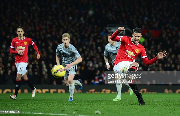 Robin van Persie of Manchester United scores from the penalty spot during the Barclays Premier League match between Manchester United and Burnley at...