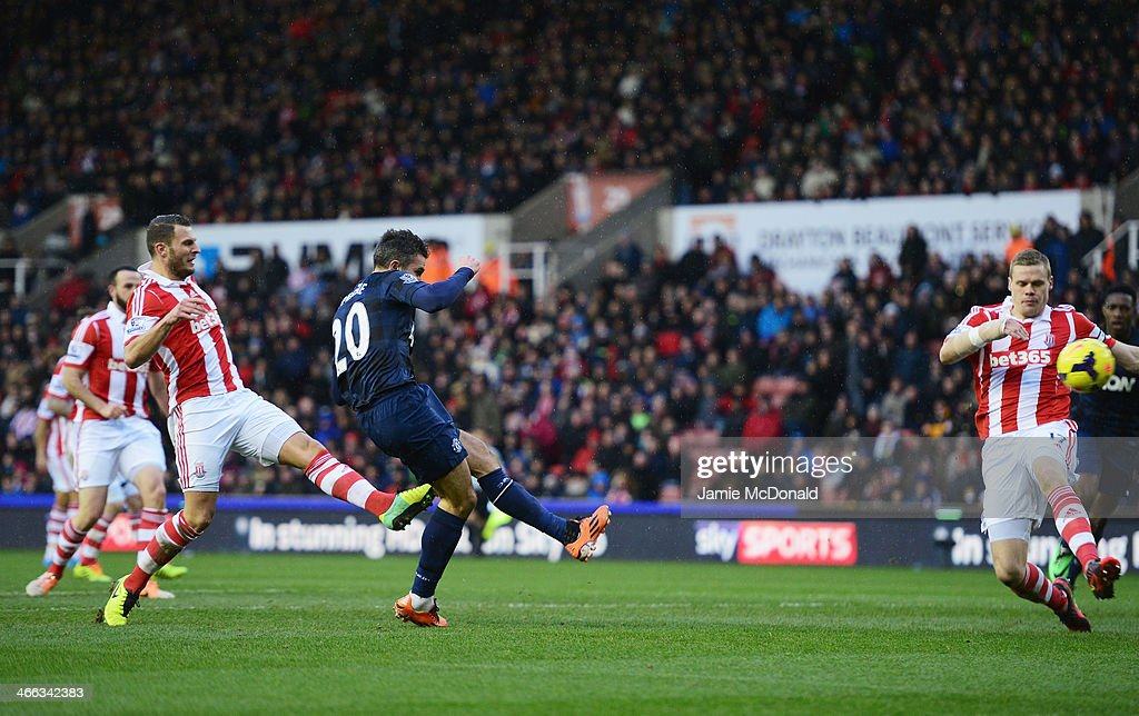 Robin van Persie of Manchester United scores his goal during the Barclays Premier League match between Stoke City and Manchester United at Britannia Stadium on February 1, 2014 in Stoke on Trent, England.