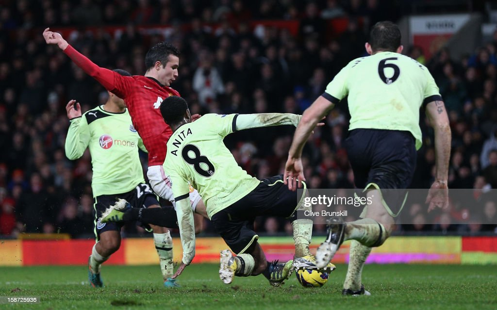 Robin van Persie of Manchester United scores the third goal during the Barclays Premier League match between Manchester United and Newcastle United at Old Trafford December 26, 2012 in Manchester, England.