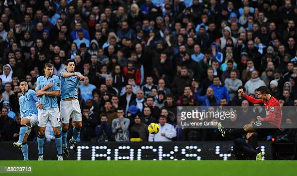 Robin van Persie of Manchester United scores the winning goal during the Barclays Premier League match between Manchester City and Manchester United...