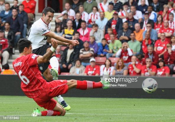 Robin van Persie of Manchester United scores their first goal during the Barclays Premier League match between Southampton and Manchester United at...